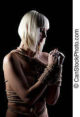 Portrait of beautiful nude blonde with hands bound