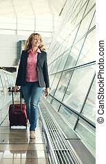 Portrait of beautiful real 35 years old woman in airport