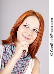 Portrait of beautiful red-haired girl. Studio shot.