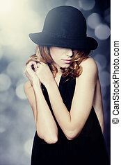 Portrait of beautiful redhead girl in hat.