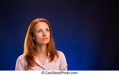 Portrait of beautiful redhead woman