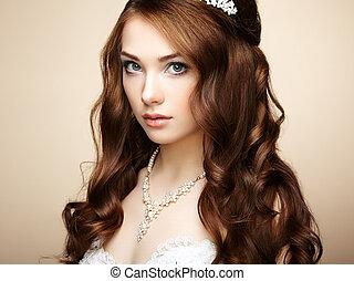 Portrait of beautiful sensual woman with elegant hairstyle. Wedding dress. Fashion photo