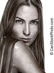 Portrait of beautiful sensual woman with freckles
