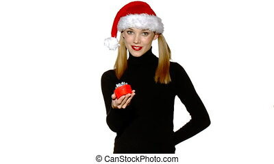 Portrait of beautiful sexy girl wearing santa claus hat showing boxed gifts