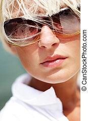Portrait of beautiful sexy woman in sunglasses