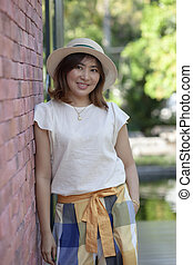 portrait of beautiful single 40s years old asian woman relaxing vacation time