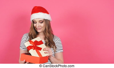Portrait of beautiful smiling girl holding gift box in hands.