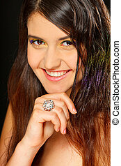 Portrait of beautiful smiling girl with ring on hand