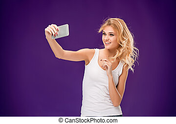 Portrait of beautiful smiling girl with modern l phone