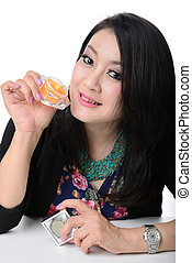portrait of beautiful smiling healthy asian woman model is holding cosmetic container