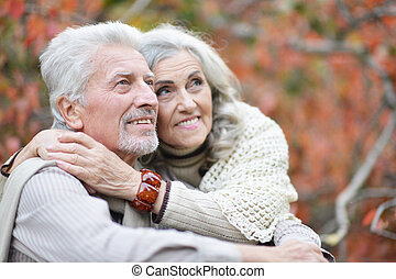Portrait of beautiful smiling senior couple hugging