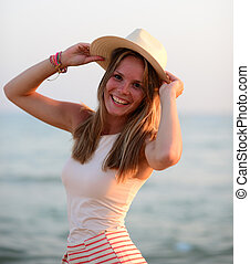 Portrait of beautiful smiling woman at beach