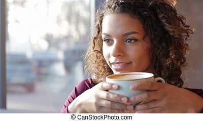 Portrait of beautiful smiling woman in a cafe