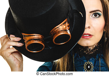 Portrait of beautiful steampunk woman isolated.