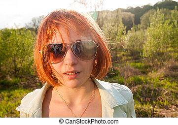 Portrait of beautiful summer girl outdoor