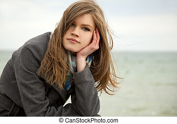 Portrait of beautiful teen girl at outdoor.