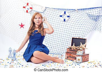 Portrait of beautiful teen girl in marine style with fishing net