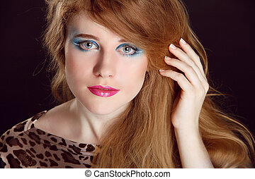 Portrait of beautiful teen woman with make up and curly healthy hair styling.