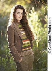 Portrait Of Beautiful Teenage Girl Outdoors In Autumn Landscape