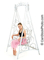 Portrait of Beautiful Teenage Girl Sitting on Elegant Metal Swing.