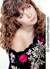 Portrait of  beautiful teenager girl with long curly hairs - isolated on white