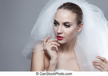 Portrait of beautiful thoughtful bride