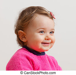 Portrait of beautiful toddler with blue eyes
