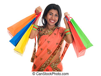 Indian woman in sari dress holding shopping bags