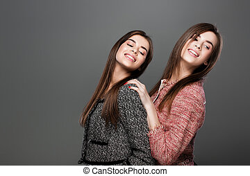 twins women with natural make-up - portrait of beautiful...
