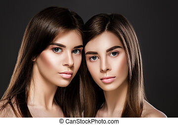 twins women with perfect skin and natural make-up - portrait...