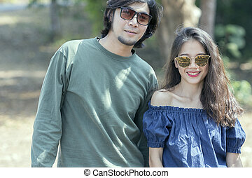 portrait of beautiful woman and handsome man standing with toothy smiling face happiness emotion