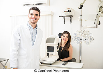 Portrait of beautiful woman and handsome optician in clinic