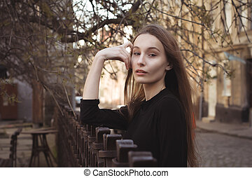 Portrait of beautiful woman at the old city