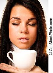 Portrait of beautiful woman drinking coffee