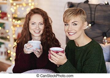 Portrait of beautiful woman drinking hot tea