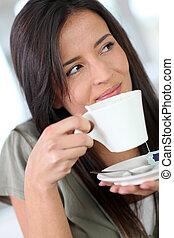 Portrait of beautiful woman drinking tea