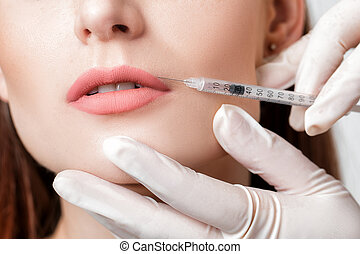 woman getting injection on lips.
