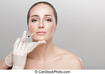 beautiful woman getting injection