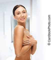 beautiful woman holding her breast