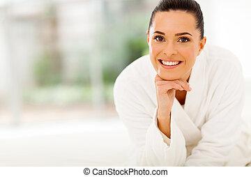 portrait of beautiful woman in bathrobe in bedroom
