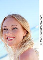 Portrait of beautiful woman in bikini at the beach