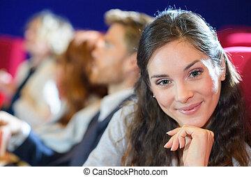 portrait of beautiful woman in cinema audience