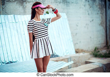 Portrait of beautiful woman in fashion clothes