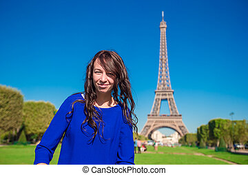 Portrait of beautiful woman in Paris background the Eiffel tower