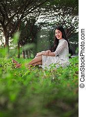 portrait of beautiful woman in park
