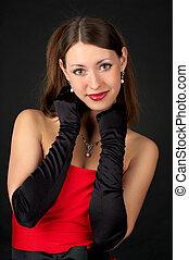 Portrait of beautiful woman in red dress
