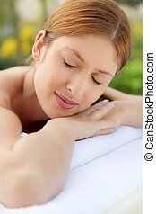 Portrait of beautiful woman in spa center