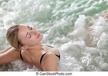 Portrait of beautiful woman in spa jacuzzi