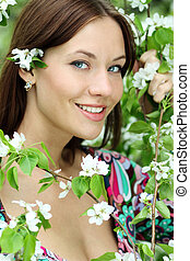 Portrait of beautiful woman in spring blossom
