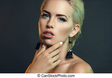 portrait of beautiful woman in studio on a dark background